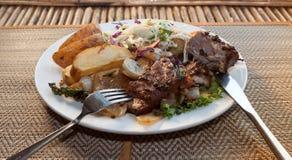 Khmer barracuda steak with vegetable salad Stock Image