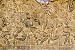 Khmer Battle frieze, Angkor Wat. An ancient bas relief frieze on a wall of Angkor Wat Temple in Siem Reap, Cambodia.  Showing the Battle of Kurukshetra between Stock Photography