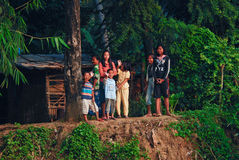 Khmer family on riverbank Stock Image
