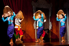 Khmer Folk Dance. Young Cambodian girls performing Harvest Dance in national clothes on January 11, 2013 in Siem Reap, Cambodia Royalty Free Stock Photo