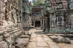 Khmer friezes on the interior of Angkor Wat. Khmer friezes on the interior walls of the ancient religious site and archaeological ruins of Angkor Wat located in Stock Images
