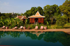 Khmer house and swimming pool Royalty Free Stock Photo