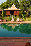 Khmer house and swimming pool Royalty Free Stock Photos
