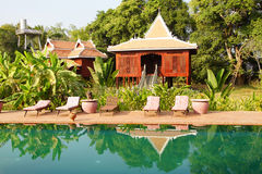 Khmer house and swimming pool Royalty Free Stock Images