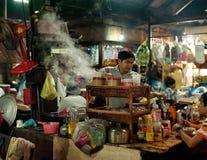 Khmer man selling food at marketplace. Cambodia Royalty Free Stock Image