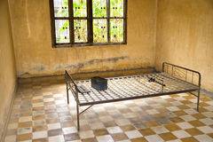 Khmer Rouge Torture Room. This is the actual room and the bed where many Cambodians were tortured and murdered by the Khmer Rouge. It used to be a classroom in a Stock Photos