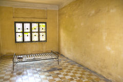 Khmer Rouge Torture Room. This is the actual room and the bed where many Cambodians were tortured and murdered by the Khmer Rouge. Formerly a school, converted Royalty Free Stock Images