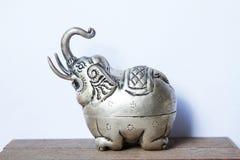 Khmer silver elephant shaped box. The elephant raised trunk,symbol of good luck. Stock Photography