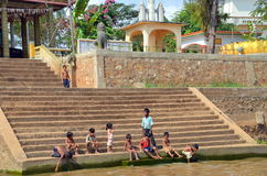 Khmer small children sit on the steps of the temple. In the Tonle Sap River, Siem Reap, Cambodia December 11, 2012 Royalty Free Stock Photos