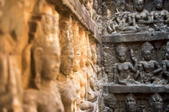 Khmer wall. With many statues Stock Image