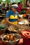 Khmer woman selling food at marketplace. Cambodia Royalty Free Stock Image