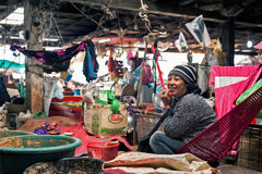 Khmer woman selling food at marketplace. Siem Reap, Cambodia Stock Image