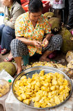 Khmer woman selling jackfruit at traditional food marketplace Stock Image