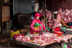 Khmer woman selling meat at marketplace. Cambodia Royalty Free Stock Photo