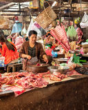 Khmer woman selling meat marketplace. Siem Reap, Cambodia Royalty Free Stock Image
