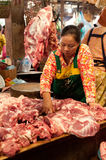 Khmer woman selling meat at traditional food marketplace Stock Images