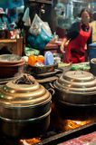 Khmer woman selling traditional food at marketplace Stock Photography