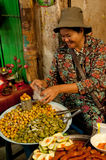 Khmer woman selling traditional food at marketplace Stock Image