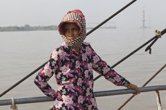 Khmer woman. With traditional scarf pn her head on the ferry crossing Mekong river Stock Images