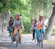 Khmer women ride bicycle to home Royalty Free Stock Images