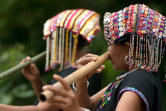 Khmu hilltribe playing flute with nose. Royalty Free Stock Photography