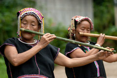 Khmu hilltribe playing flute with nose. Royalty Free Stock Images