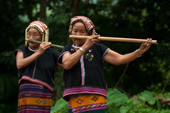 Khmu Hilltribe Playing Flute With Nose. Stock Photo
