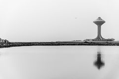 Khobar water tower reflection. A black and white image of a water tower reflected in a pool of water on reclaimed land on the Arabian Gulf coast north of the Royalty Free Stock Image