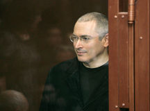 Khodorkovsky. Jailed Russian former oil tycoon Mikhail Khodorkovsky stands behind the glass of the defendants' cage before the start of a court session December Stock Images