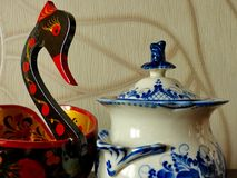 Khokhloma bucket in the form of a bird and sugar bowl Gzhel. Things in Russian traditional Khokhloma and Gzhel style. Stock Images