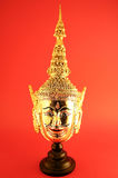 Khon som liknar det guld- huvudet arkivfoto