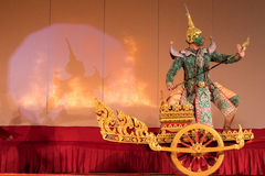 Khon, Traditional Thai dance drama. It is traditionally performed solely in the royal court, back lit by real fire as it originally set up at Wat Khanon Nang Stock Photos