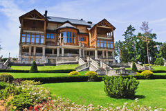 The Khonka house and flower garden in Mezhyhirya. Ukraine. It is former residence of ex-president Yanukovich, now it is open to the public Royalty Free Stock Photo