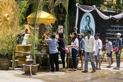 Thai people celebrate Songkran Festival by pouring water over Buddha statue to signify cleansing for the new year. KHONKAEN, THAILAND - APRIL 13, 2017 : Thai stock image