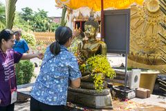 Thai people celebrate Songkran Festival by pouring water over Buddha statue to signify cleansing for the new year. KHONKAEN, THAILAND - APRIL 13, 2017 : Thai royalty free stock images