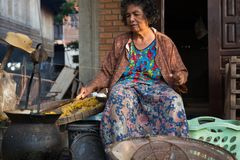 Khonkean,Thailand Oct 25 : Khonkean Thailand October 25 2017  ol. Khonkean,Thailand Oct 25 : Khonkean Thailand October 25 2017 old woman is removing the silk Royalty Free Stock Images