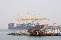 Khor Fakkan UAE Large cargo ships docked to load and unload goods at Khor Fakkport Royalty Free Stock Image