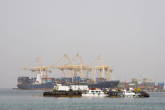 Khor Fakkan UAE Large cargo ships docked to load and unload goods at Khor Fakkport Stock Photo