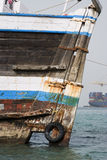 Khor Fakkan UAE old wooden dhow washed up on shore in front of Khor Fakkport Stock Images