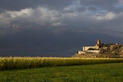 Spotlight over the Khor Virap Monastery, in Armenia. Khor Virap Monastery and dramatic sky Stock Photography