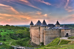 Khotyn fortress at sunset. Dawn fortress bastion of the Dniester River in Khotin on a background of dawn of the legends of history of Ukraine in Eastern Europe Royalty Free Stock Images