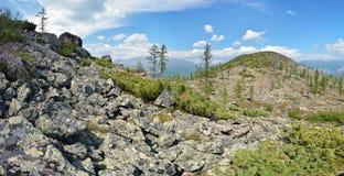 Stitched Panorama. Neighborhood of the village of Ust-Nera. Oymyakon. Yakutia. Sarychev`s ridge Khrebet Sarycheva or Tas-Kystabyt royalty free stock images