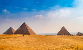 The Khufu Pyramid in Egypt. The huge old pyramids stand on the wilderness of Egypt with blue sky royalty free stock image