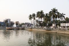 Khulna, Bangladesh, February 28 2017: City center with park. And pond in Khulna in the evening light royalty free stock photo