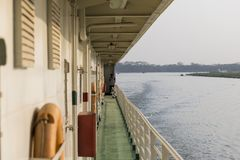 Khulna, Bangladesh, March 1 2017: Cabin deck of a passenger ferry. With a view of the river landscape in the evening light Royalty Free Stock Photography