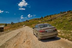 KHULO, GEORGIA - 08 August 2017:  Mountain unpaved road between Stock Photos