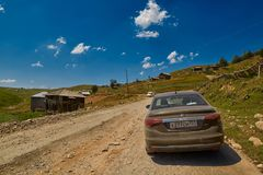 KHULO, GEORGIA - 08 August 2017:  Mountain unpaved road between Royalty Free Stock Image