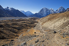 Khumbu Glacier Valley. Looking down the Khumbu Glacier valley towards Thamserku Kangtega Tabuche and Cholatse peaks Royalty Free Stock Photo