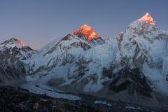 Khumbutse, Mt. Everest and Nuptse at Sunset. Last rays of sunlight on peaks above Khumbu Glacier, Khumjung, Solu Khumbu, Nepal Royalty Free Stock Photography