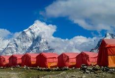 Everest Base Camp tents on Khumbu glacier EBC, Nepal side. Khumbutse overlooks a sprinkling of colored tents EBC, Nepal side. Nepalese south Everest Base Camp Royalty Free Stock Images